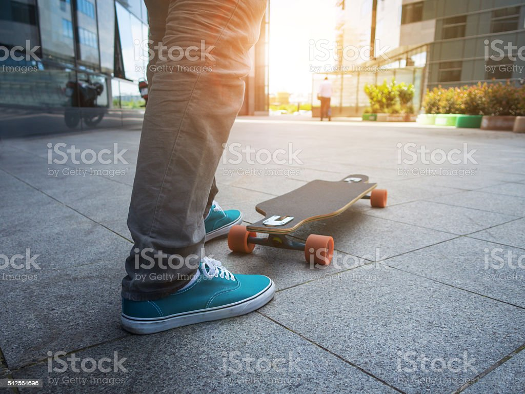 Man and longboard in the city stock photo