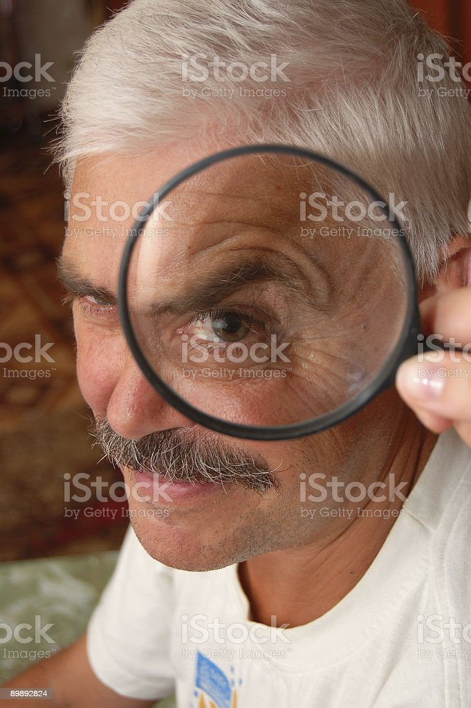 Man and magnifier royalty-free stock photo