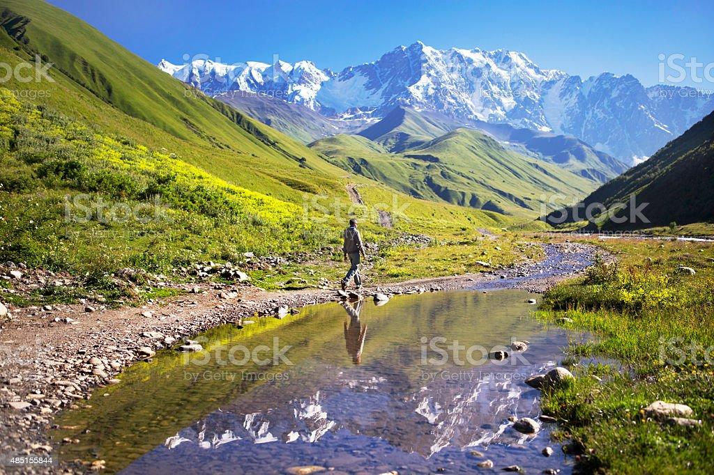 Man and Mountains stock photo