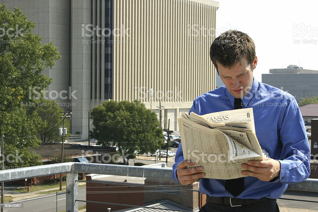 Man and Newspaper in City royalty-free stock photo