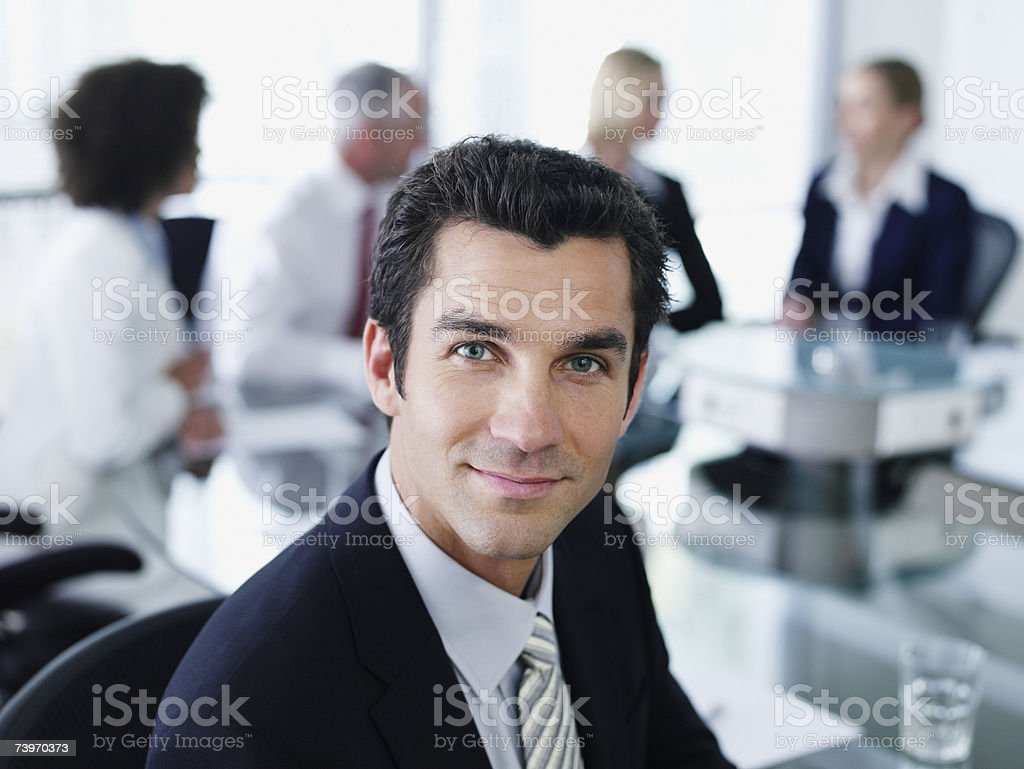 Man and office colleagues in a boardroom meeting royalty-free stock photo