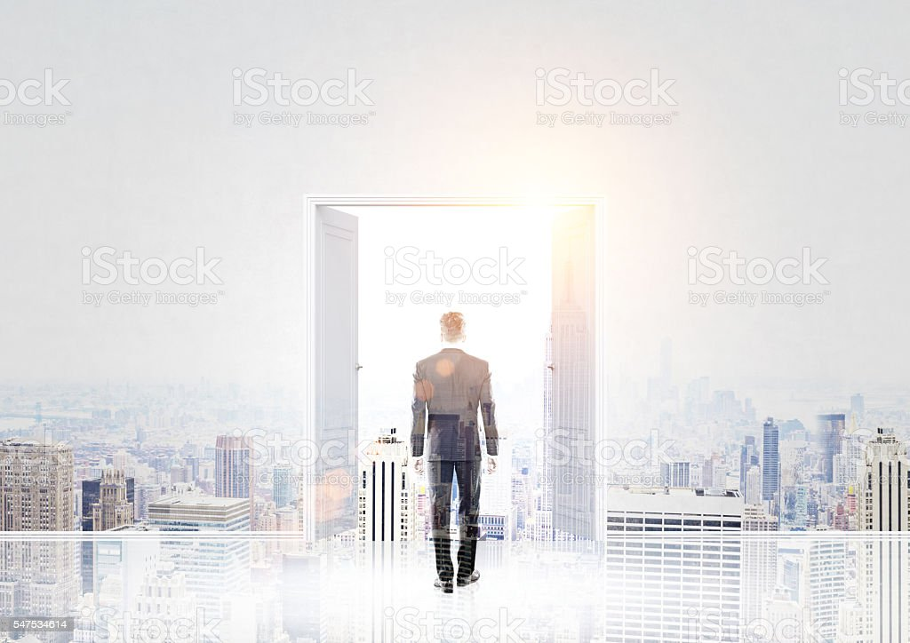 Man and open door multiexposure stock photo