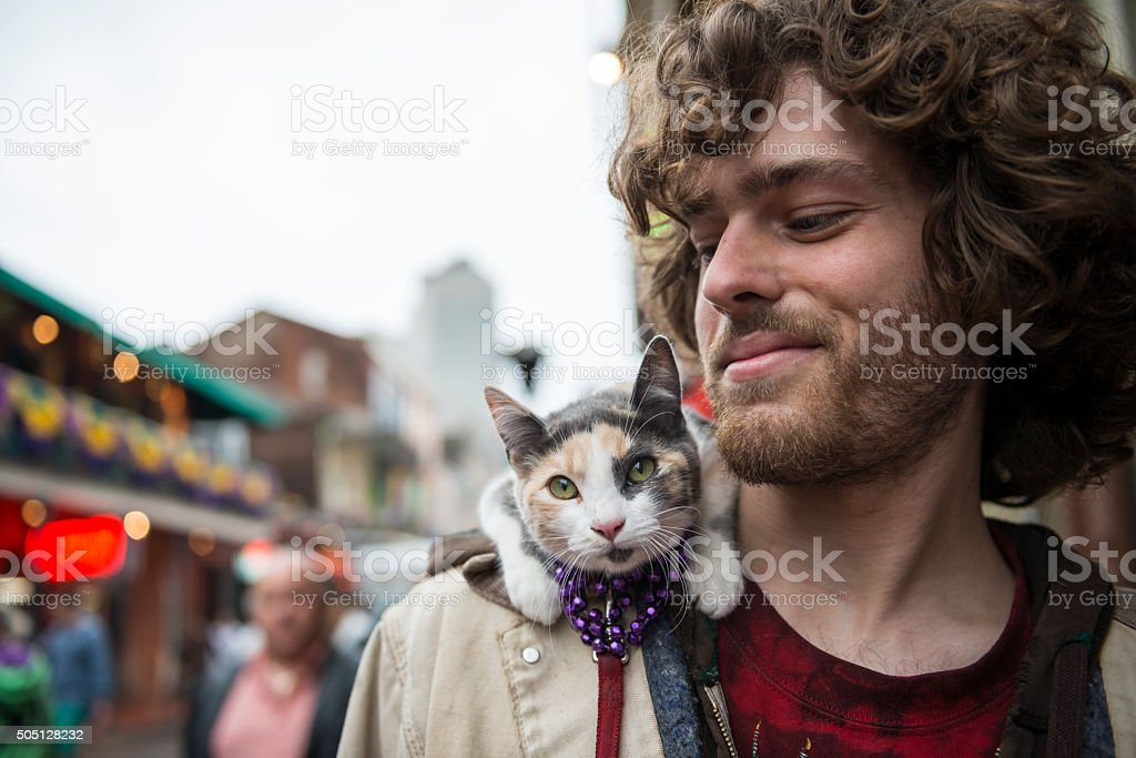 Man and pet cat at Mardi Gras - New Orleans stock photo