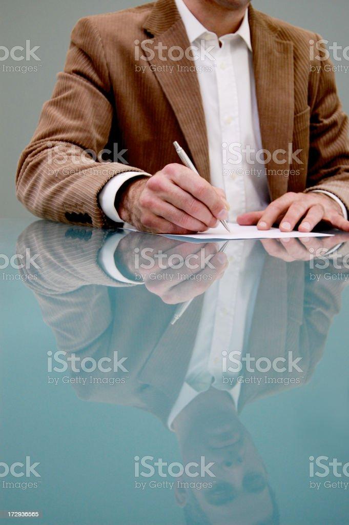 Man and reflection, signing his life away! royalty-free stock photo