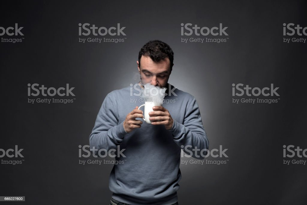 Man and Smoke fragments on a black background stock photo