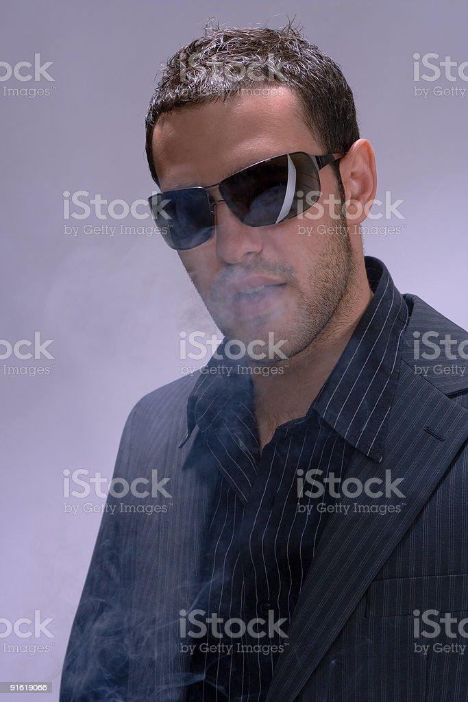 man and smoke stock photo