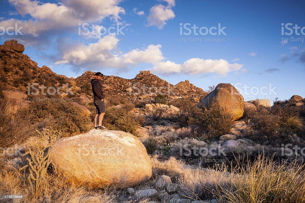 man and southwest landscape sunset stock photo
