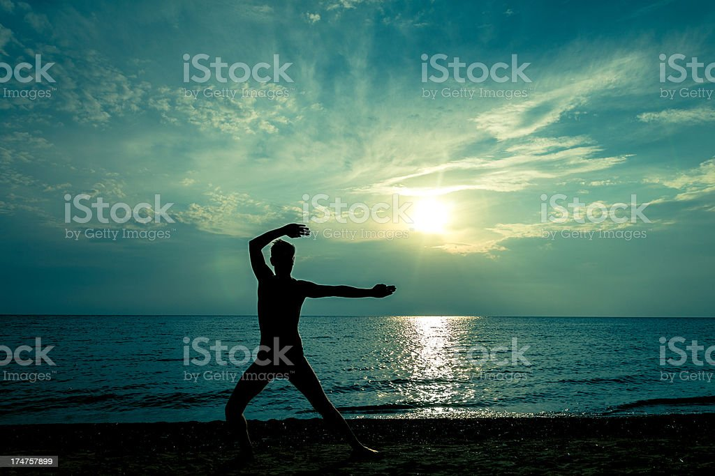 man and sunset on the sea royalty-free stock photo