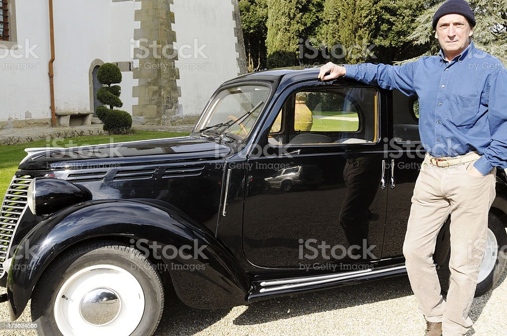 Man and Vintage Italian Car Fiat 1100 royalty-free stock photo