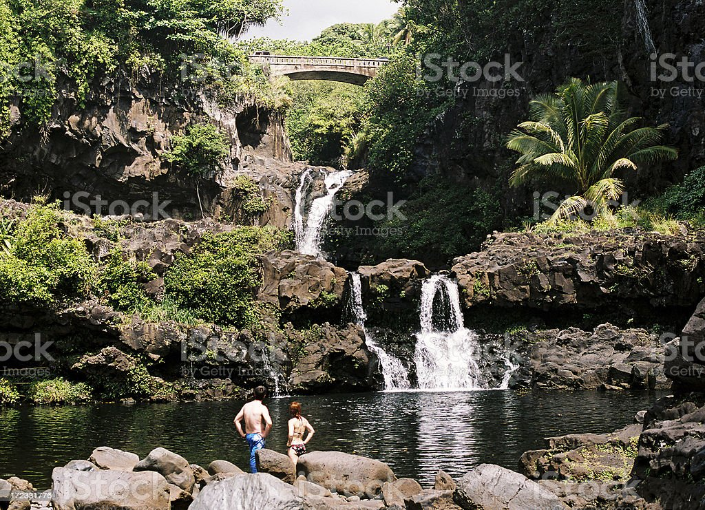 Man and woman at Hana Maui Hawaii waterfall royalty-free stock photo