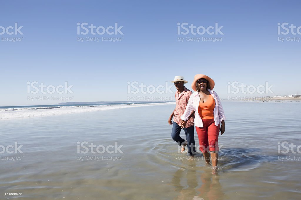 Man and woman at the beach stock photo