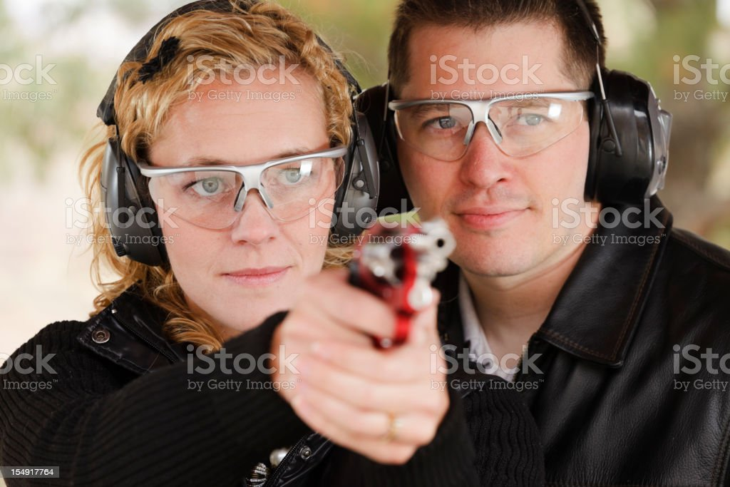 Man and Woman at the Shooting Range royalty-free stock photo