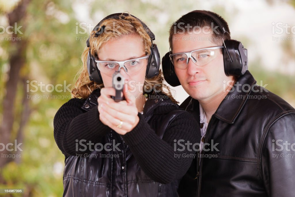 Man and Woman at the Shooting Range royalty-free stock photo