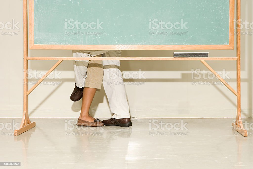 Man and woman behind a blackboard stock photo