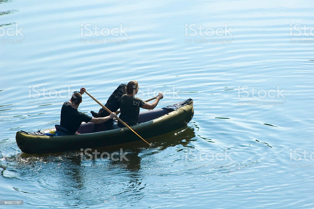 Man and woman canoeing royalty-free stock photo