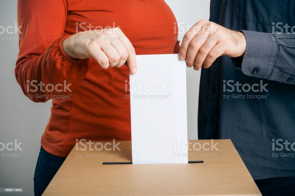man and woman casting their vote royalty-free stock photo