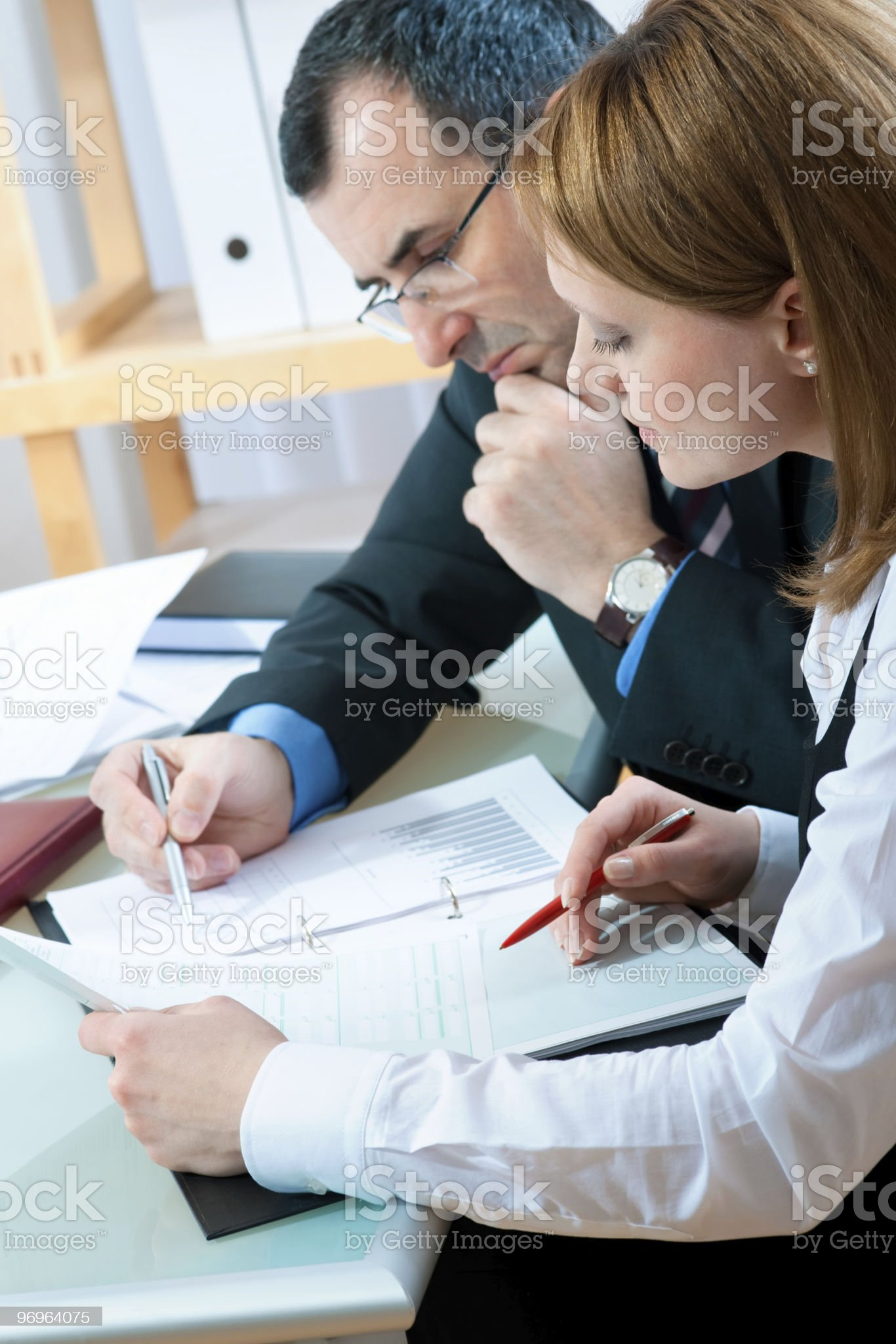 Man and woman check figures at business meeting royalty-free stock photo