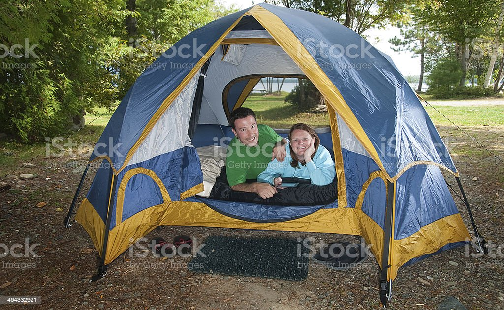 Man and Woman Couple on an Outdoors Tent Camping Vacation stock photo