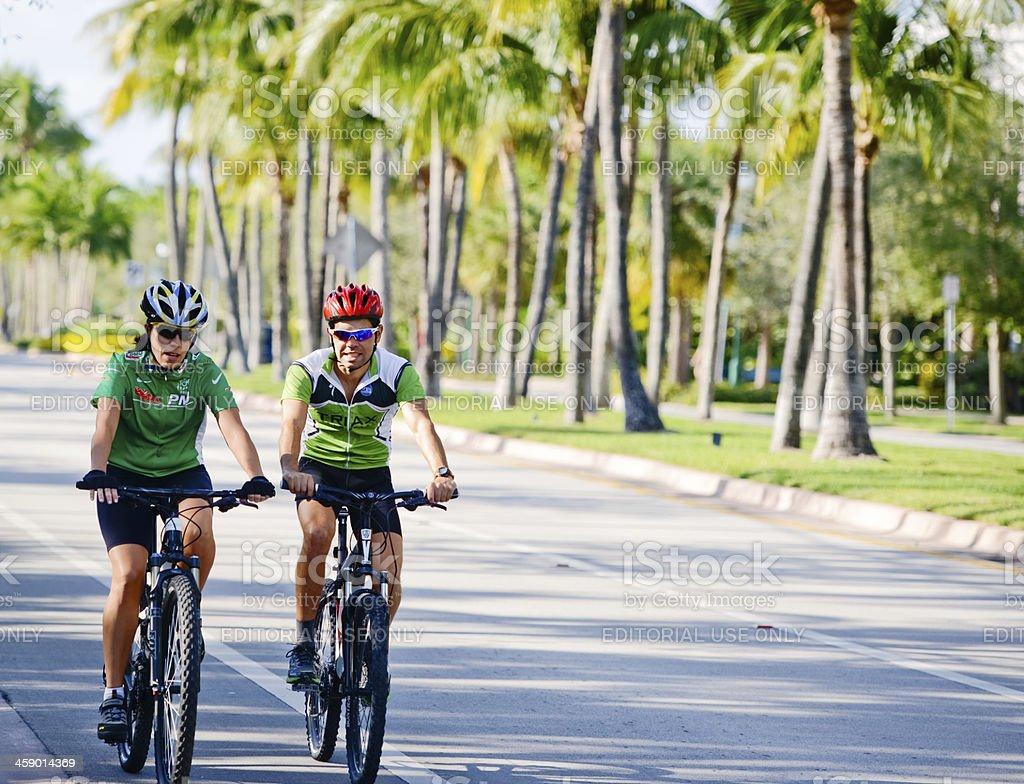 Man and Woman cycling on Key Biscayne, Florida, USA stock photo