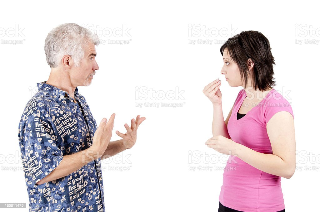 Man and woman discussing Food in ASL stock photo