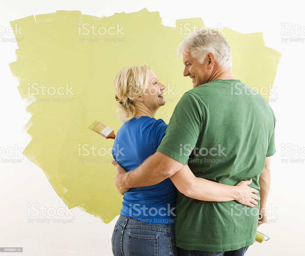 Man and woman discussing paint job. royalty-free stock photo
