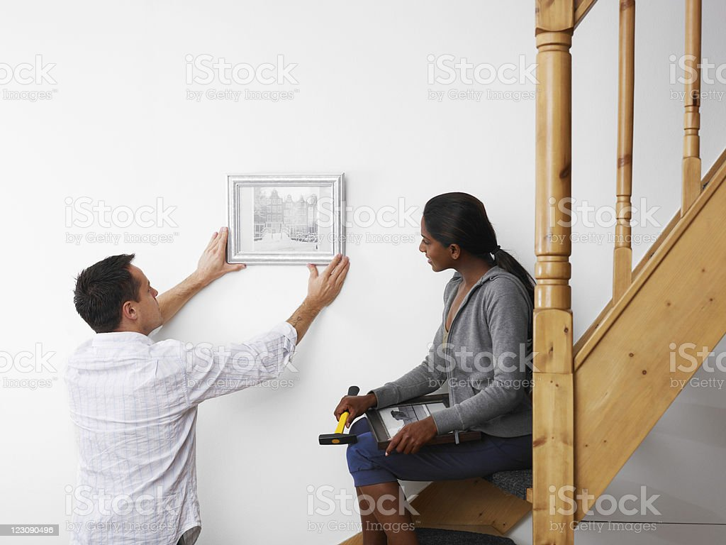 man and woman doing diy work at home royalty-free stock photo