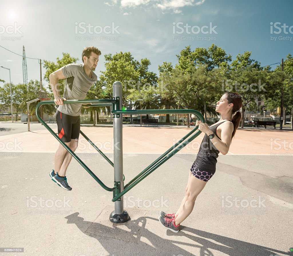 Man and woman doing exercises in the city stock photo