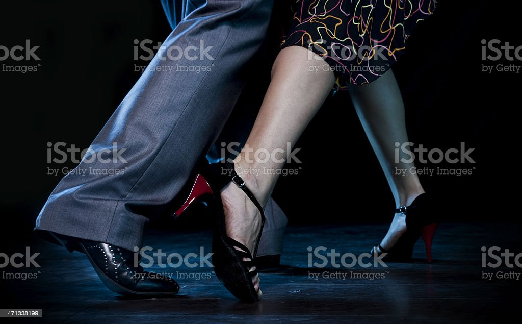 Man and woman doing the passionate tango stock photo