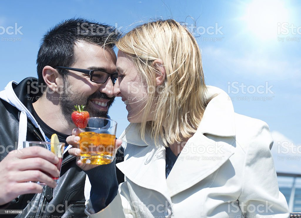 Man and Woman drinking an aperitif stock photo