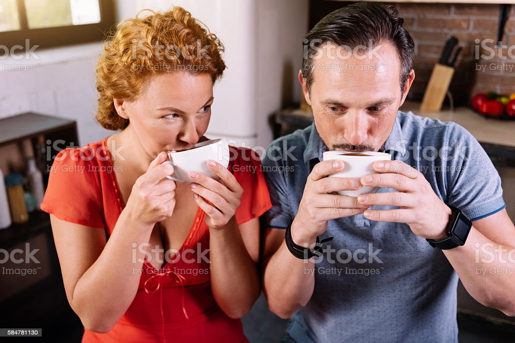 Man and woman drinking coffee stock photo
