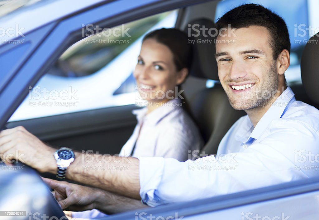 Man and woman driving royalty-free stock photo