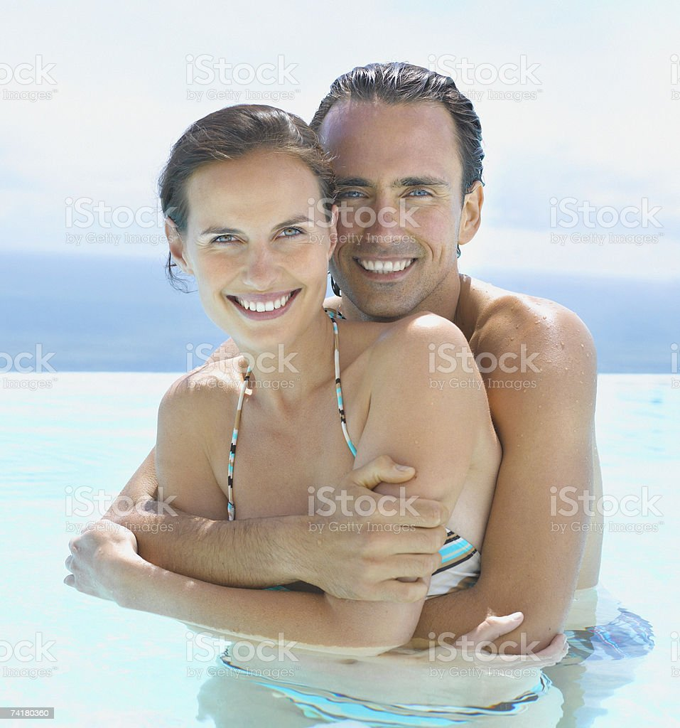 Man and woman embracing in water royalty-free stock photo