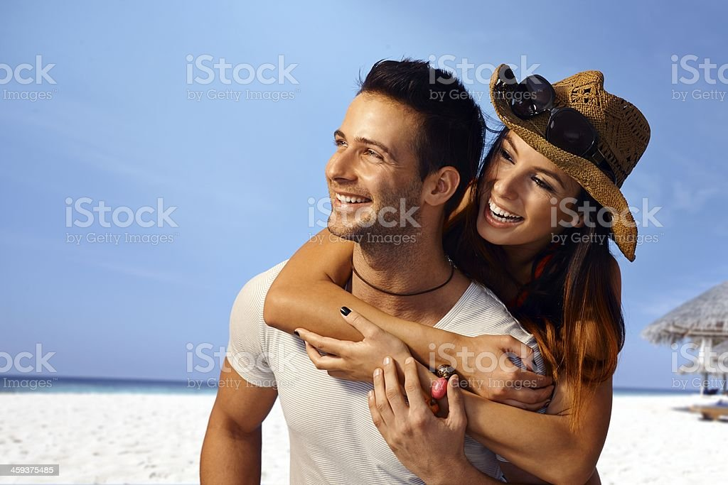 A man and woman enjoying a summer holiday on the beach royalty-free stock photo