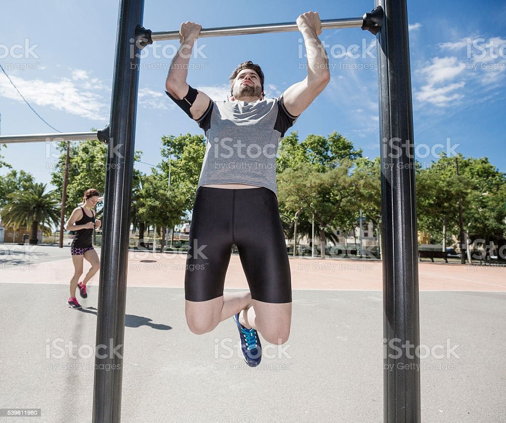 Man and woman exercising in the city stock photo