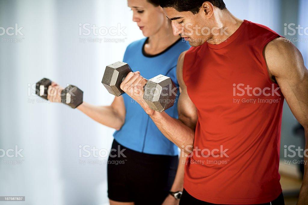Man and Woman Exercising royalty-free stock photo