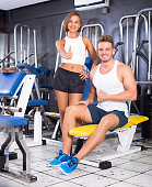 man and woman fitness coaches in gy