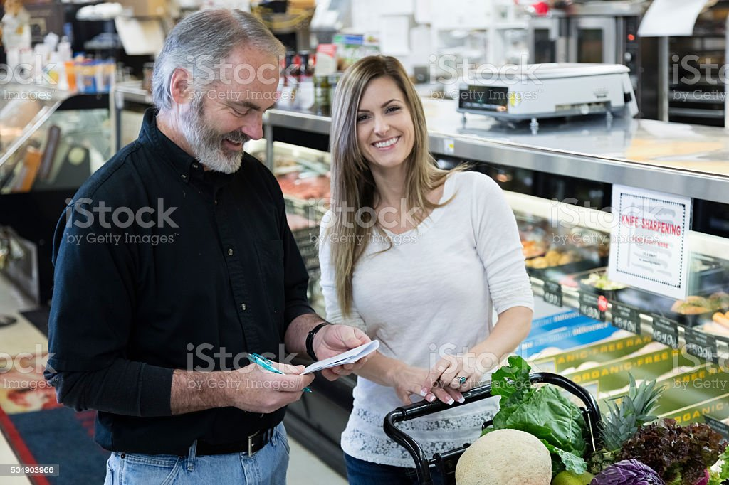 Man and Woman Grocery Shopping stock photo