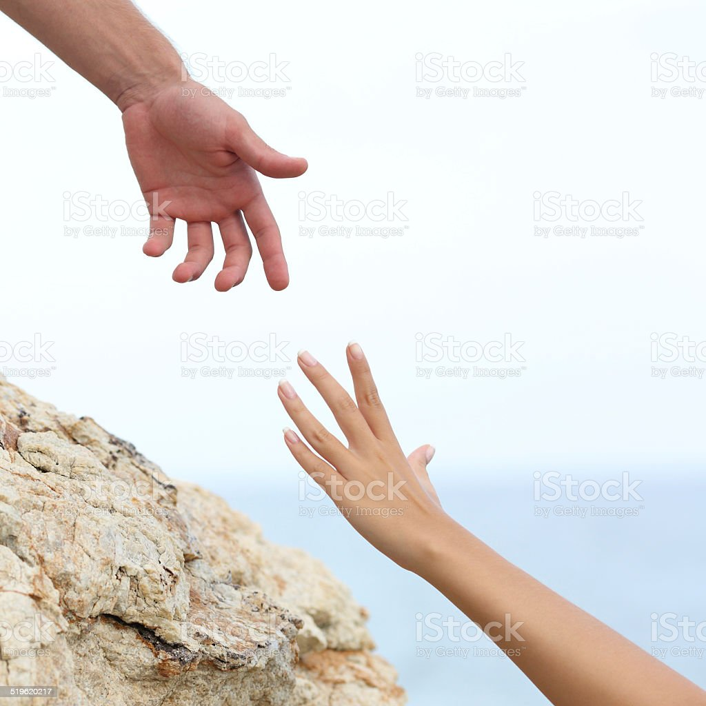Man and woman hands helping concept stock photo
