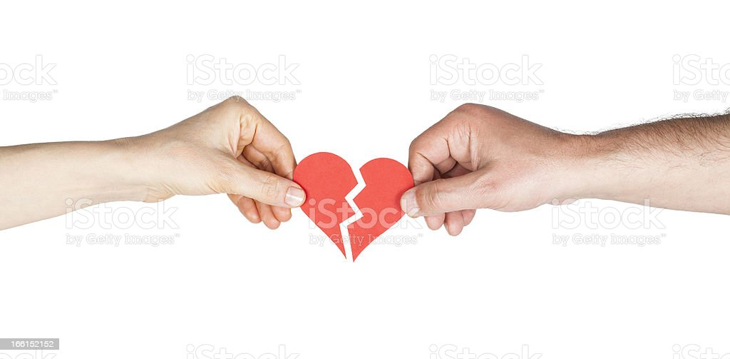 Man and woman hands holding broken heart royalty-free stock photo