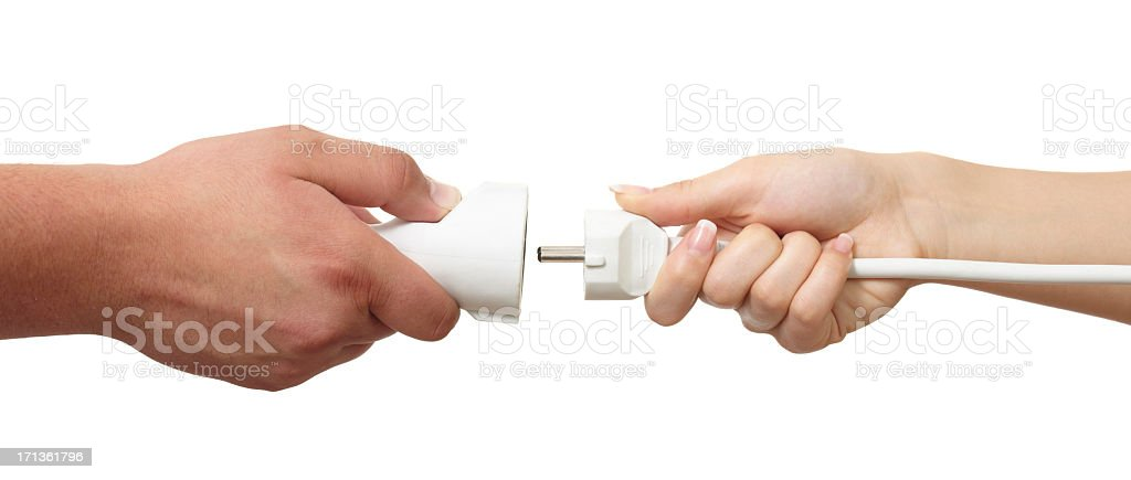 Man and woman hands holding European plug and outlet isolated stock photo