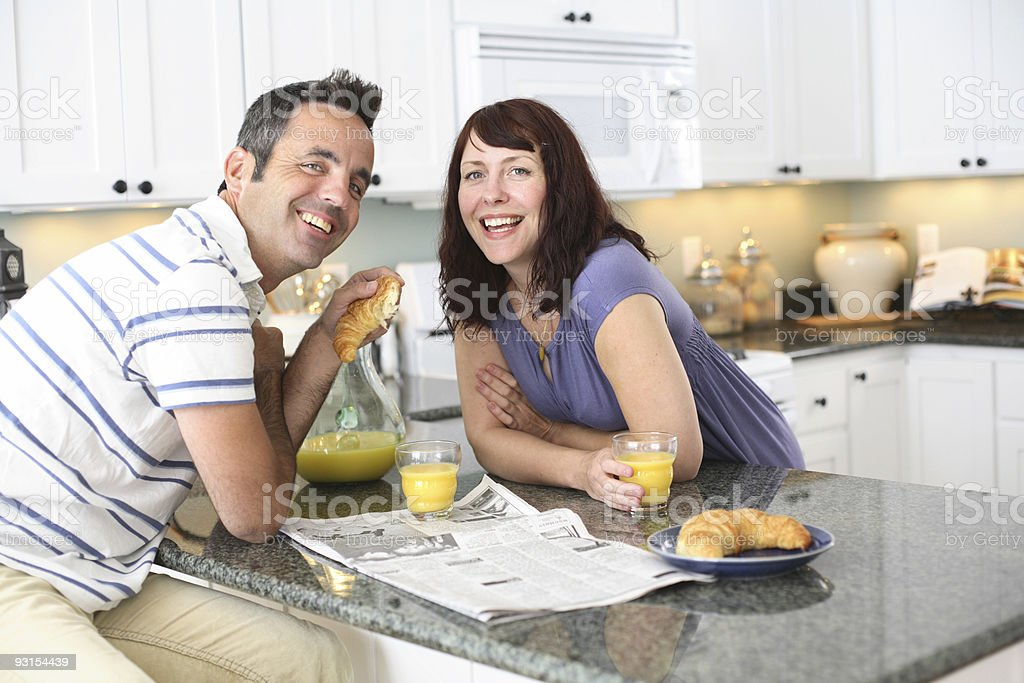 Man and woman having breakfast in kitchen royalty-free stock photo