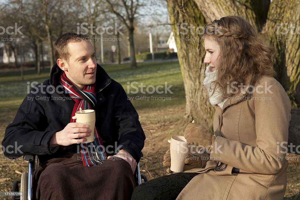 Man And Woman Having Coffee At Park stock photo