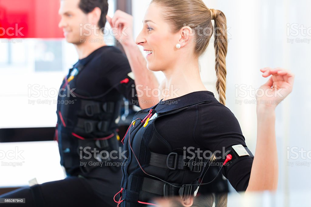 Man and woman having ems training stock photo