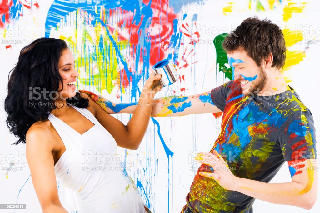 Man and Woman Having Fun with Paint stock photo