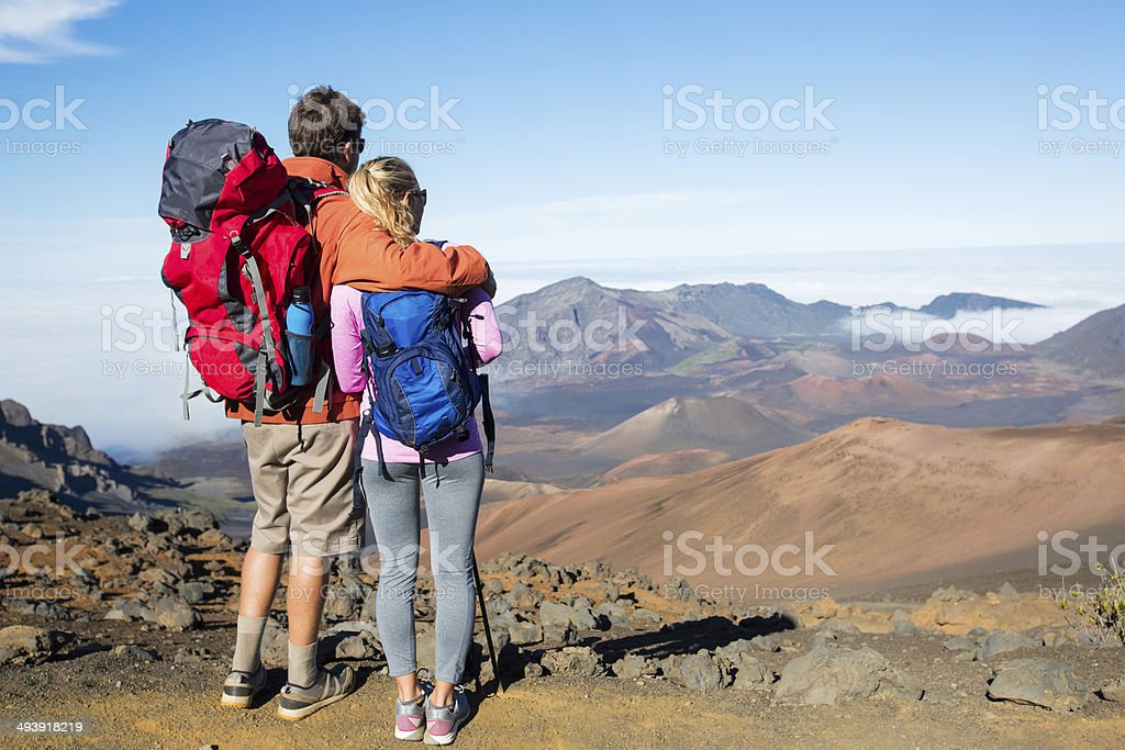 Man and woman hiking on beautiful mountain trail stock photo