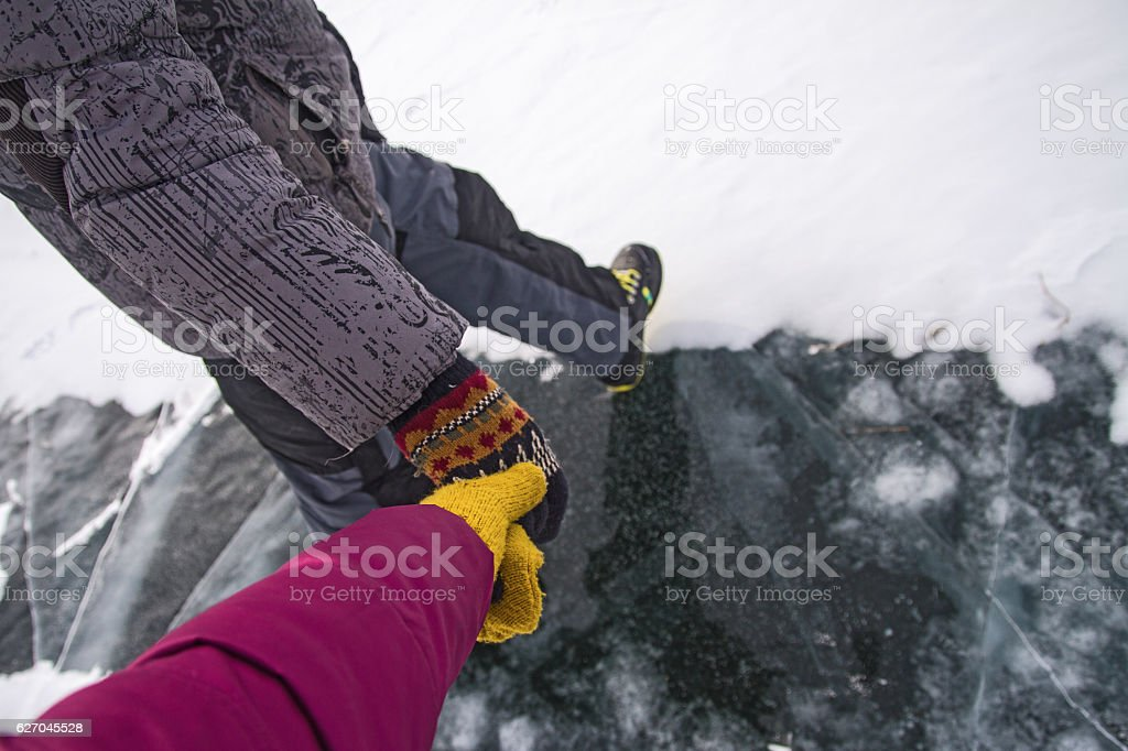 Man and woman holding hands in the winter. stock photo