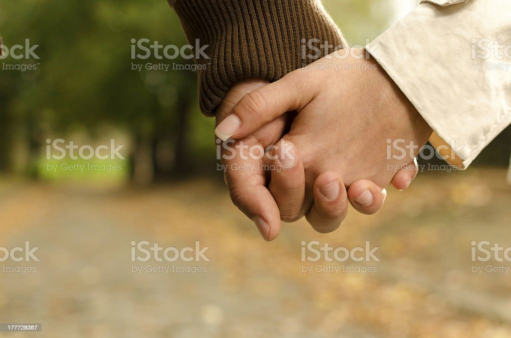Man and woman holding hands royalty-free stock photo