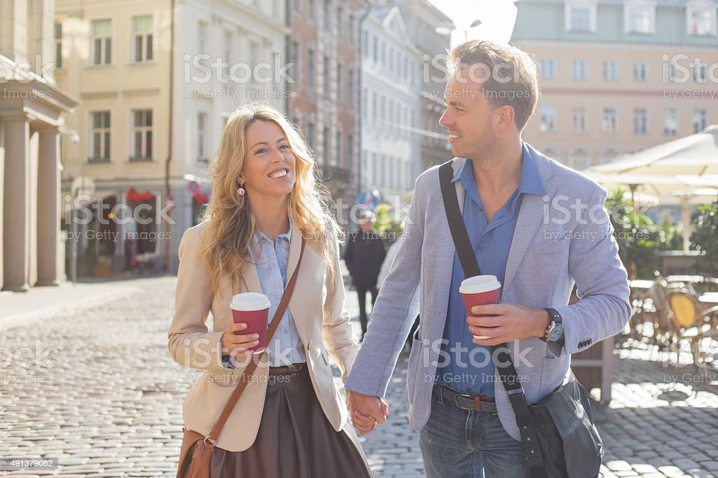 Man and woman holding hands stock photo