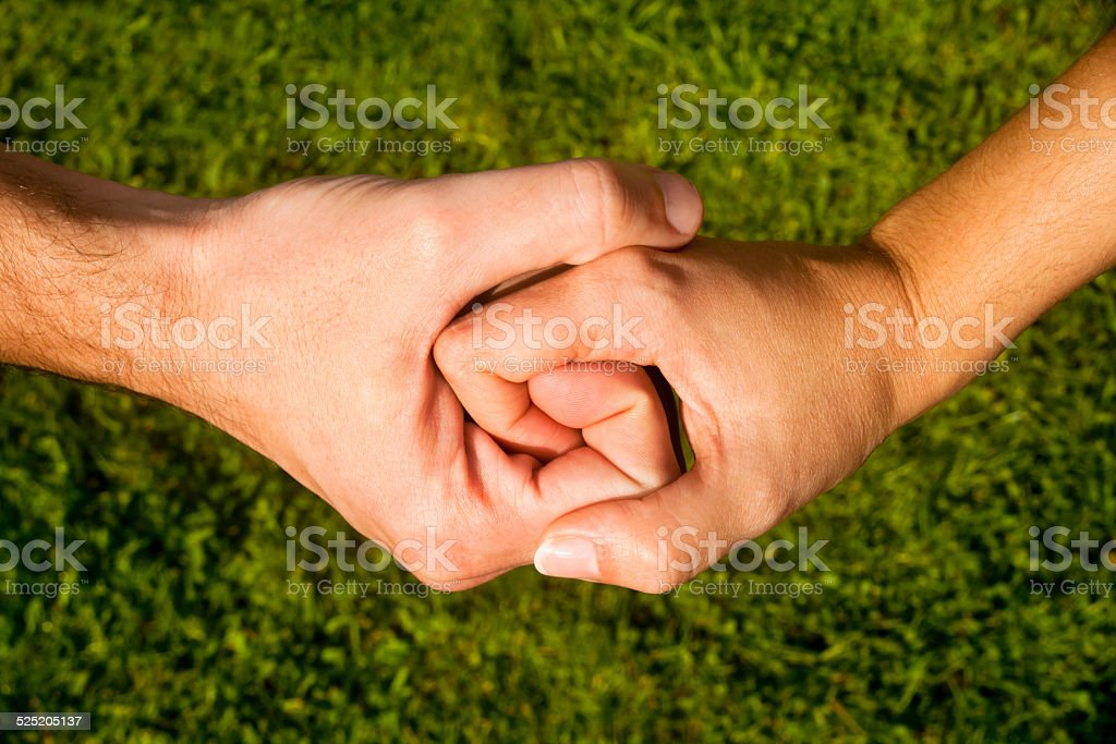 Man and woman holding on to each other. stock photo