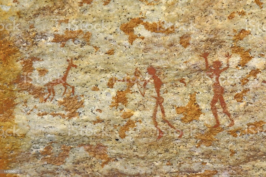 man and woman hunting animal bushman's tribal wall artwork stock photo
